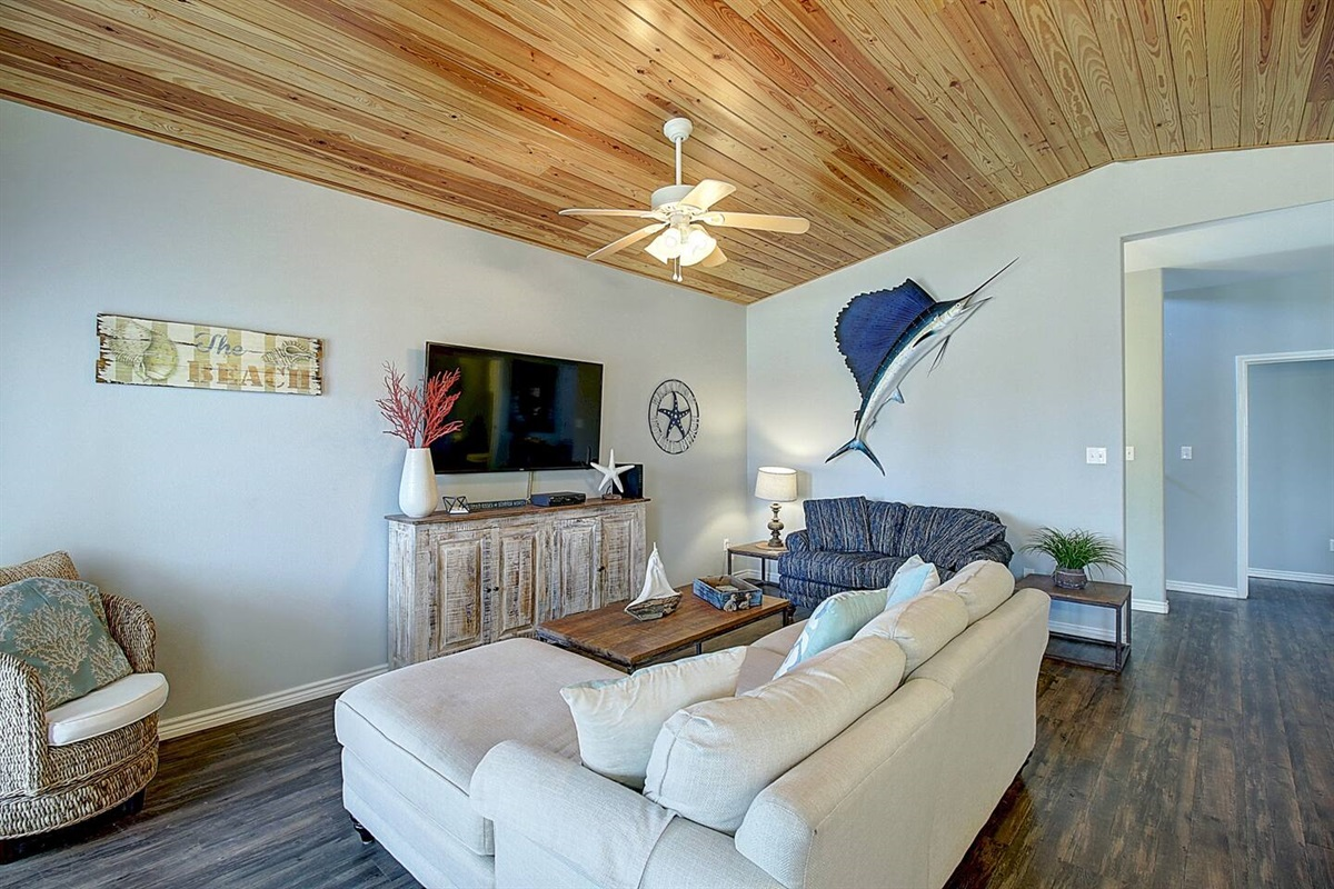 Spacious Living Area:  60 inch flat screen TV.  Spectrum Cable and Wifi.