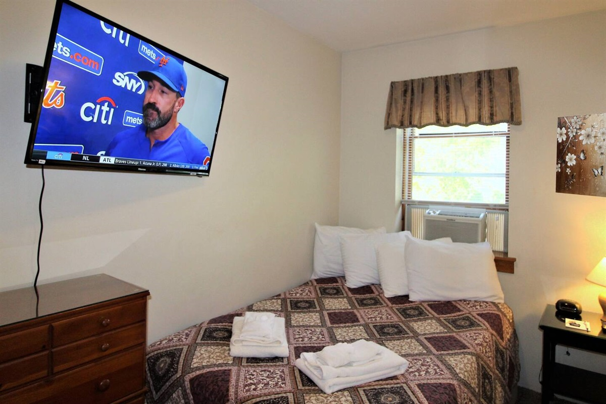 "Bedroom #1 with full bed and 43"" (or larger) flat screen smart Roku TV.  Just bring your favorite streaming apps and watch all your sports teams or other must-see TV!"
