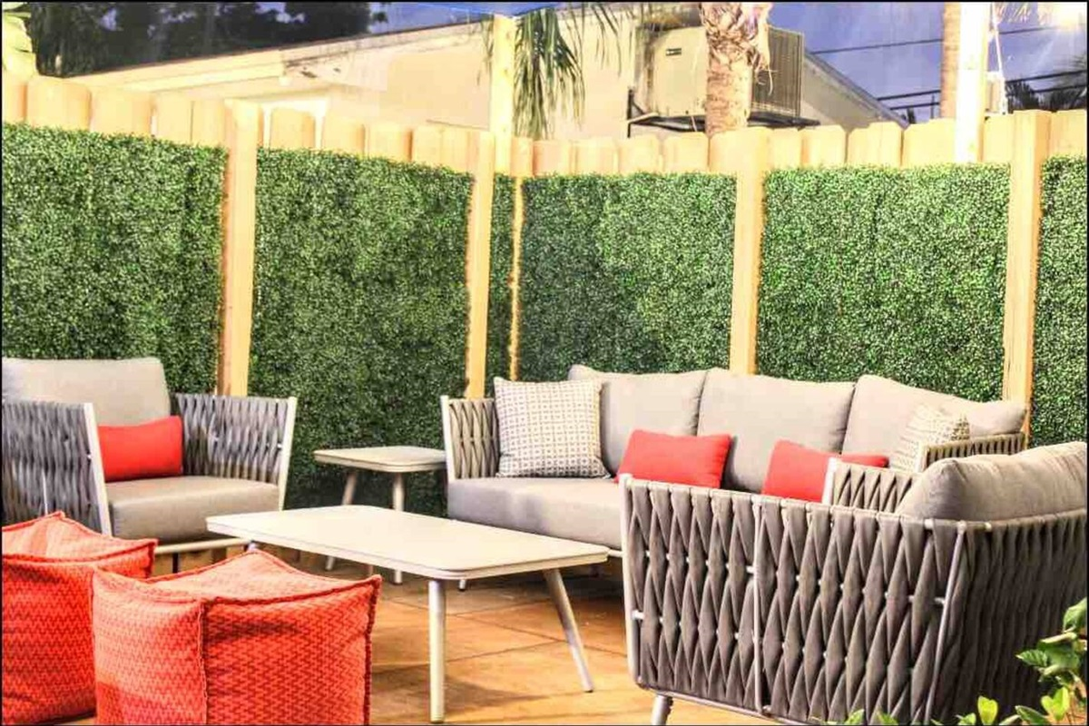 The main communal seating area during your outdoor evenings.  It features 2 side tables and one larger coffee table so you can informally dine or drink al fresco. The two red ottomans act as both individual seating or as a comfy footrest. :-)