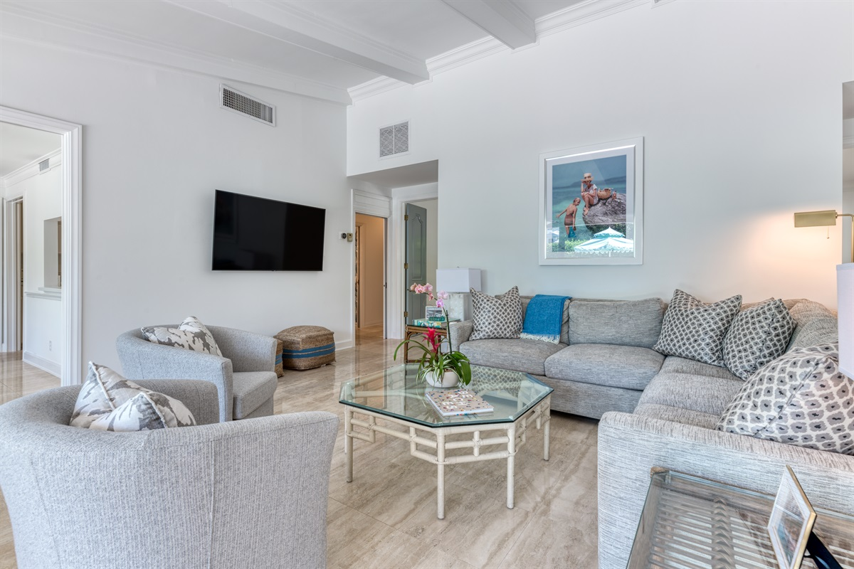 The family- living room is open, spacious, stylish and perfect for families to get together play some games, listen to music or relax in front of the Large SMART App TV. The huge windows let in beautiful natural light and views of the tranquil courtyard.