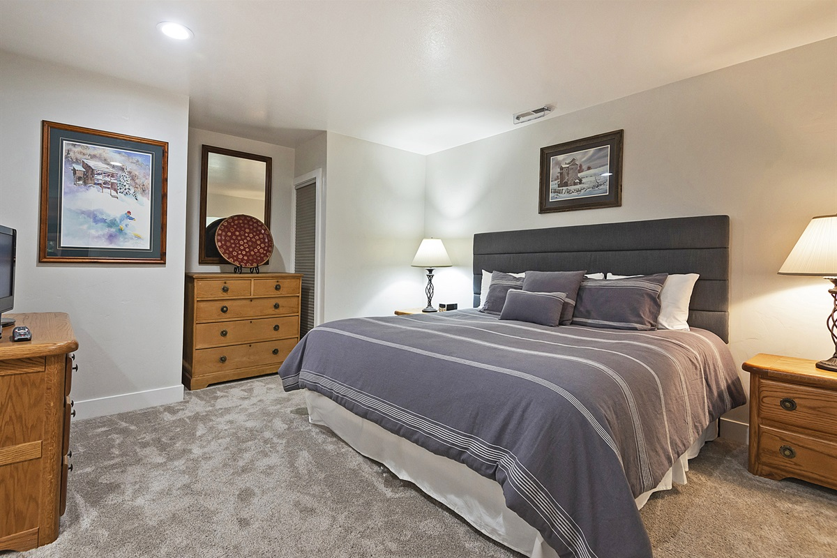 Master Bedroom with King size bed, TV, ensuite bath
