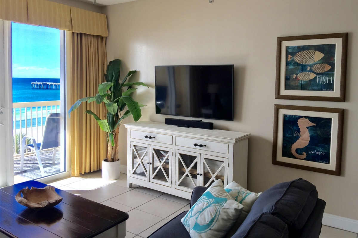 "Gulf front Living room with 55"" Smart TV and view of the Pier"