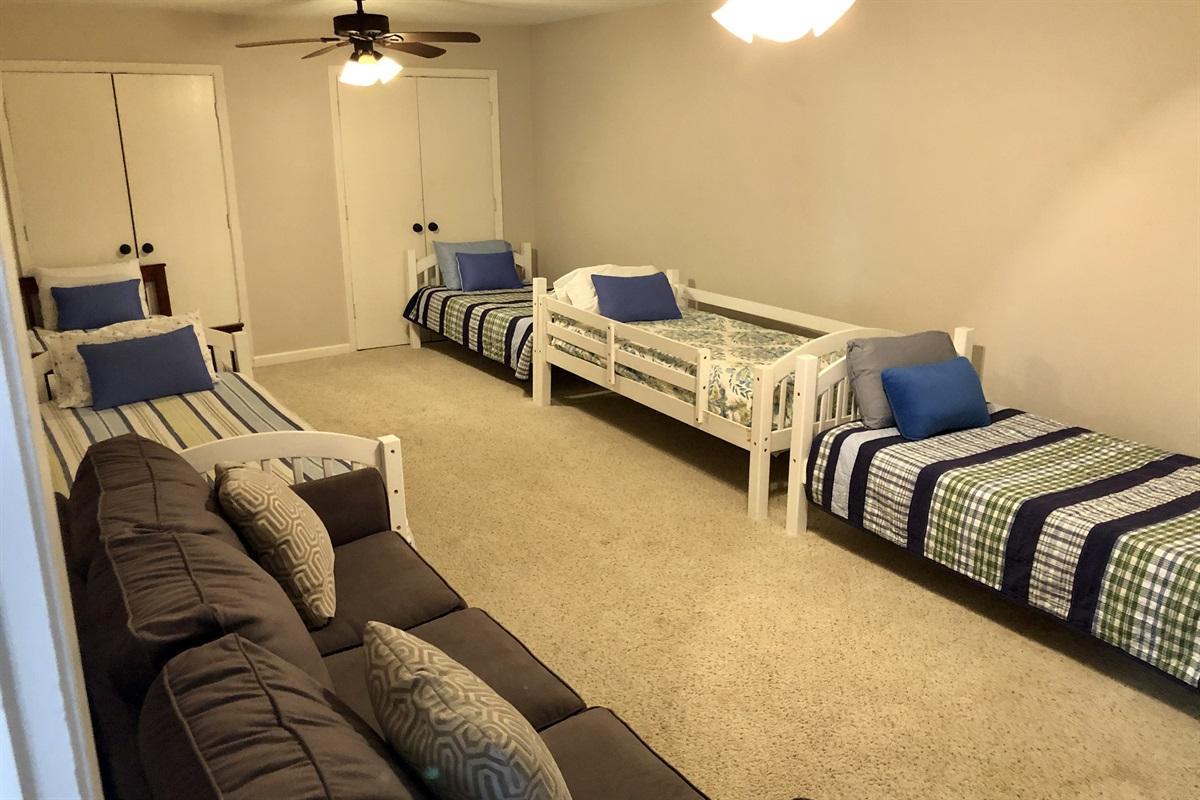 Bunk room in basement. 5 twin beds.