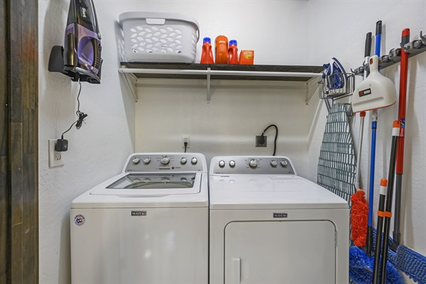 Laundry closet - commerical washer/dryer, iron/iron board, misc cleaning items