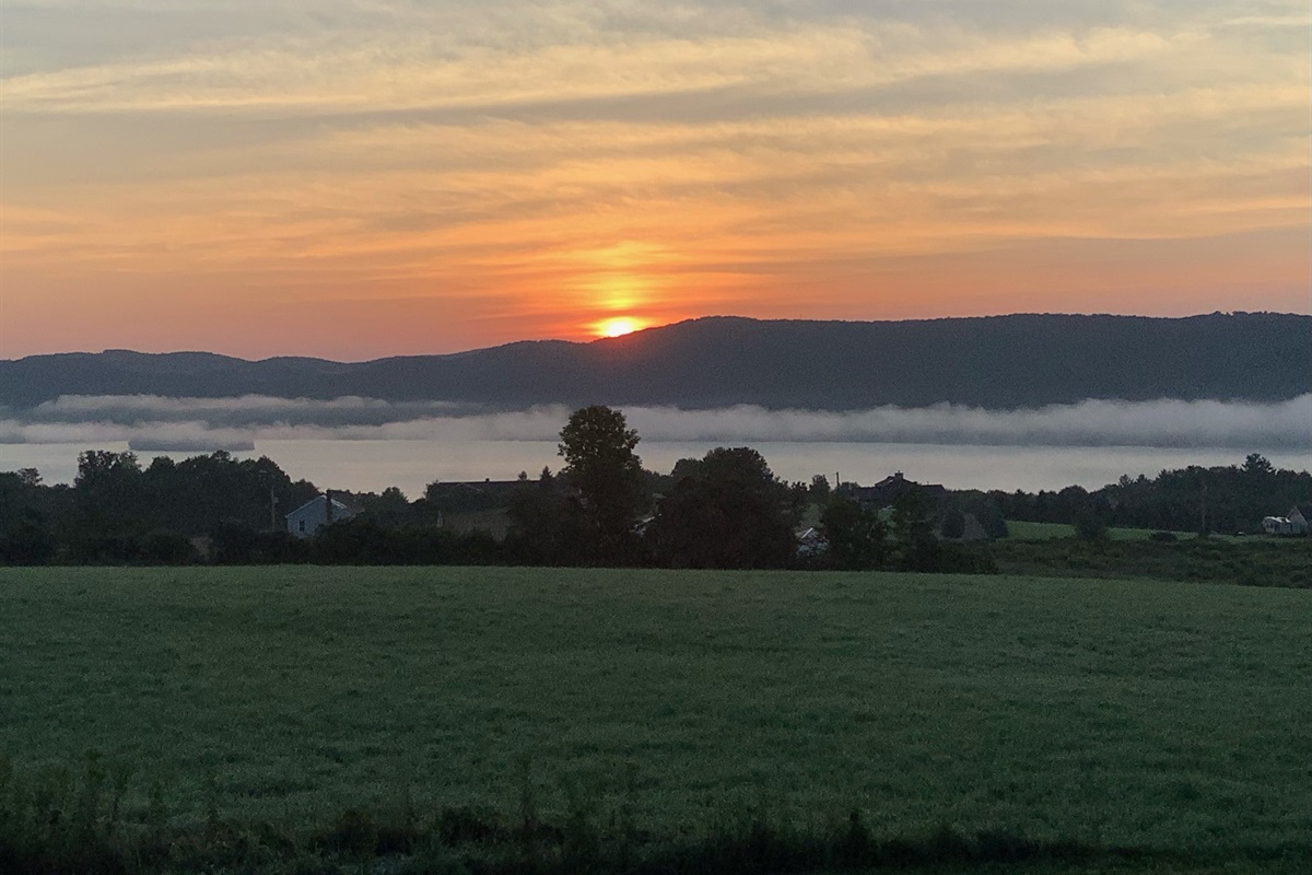 Sunrise over Canadarago with lifting morning fog