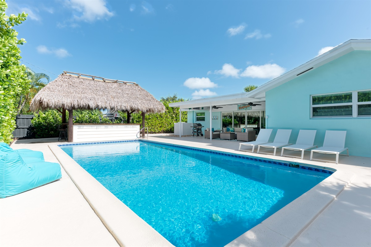 Newly renovated 4 Bed/ 3 Bath Saltwater Pool home beautifully decorated and located in a sought after location in Palm Beach Gardens. To top it off, there is an amazing Tiki Bar & Fire Pit!