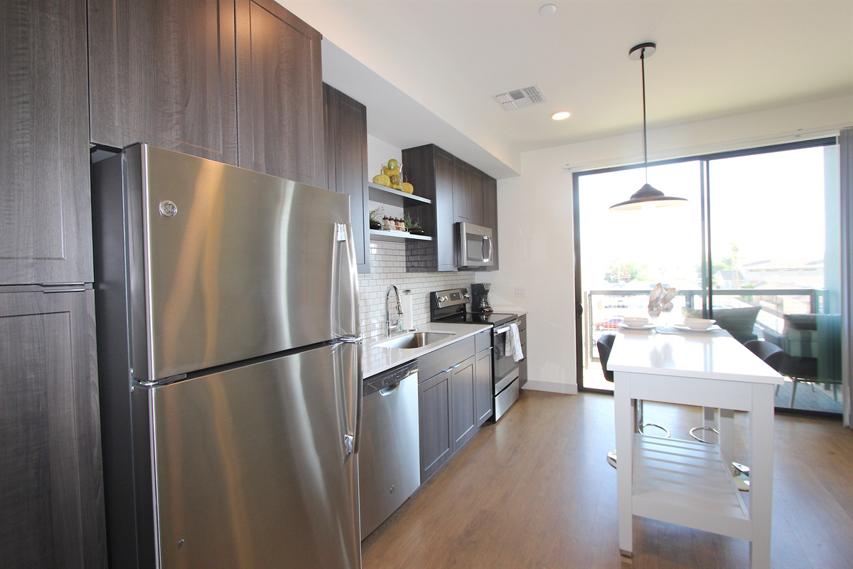 Kitchen with new stainless steel appliances, center island