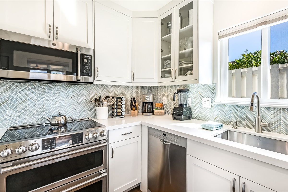 The kitchen features high-end All-Clad cookware, spices, and kitchen tools for the cooking enthusiast.