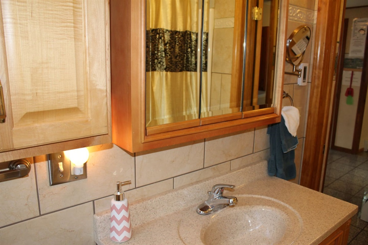 Modern, recently renovated, fully tiled bath with heated floor