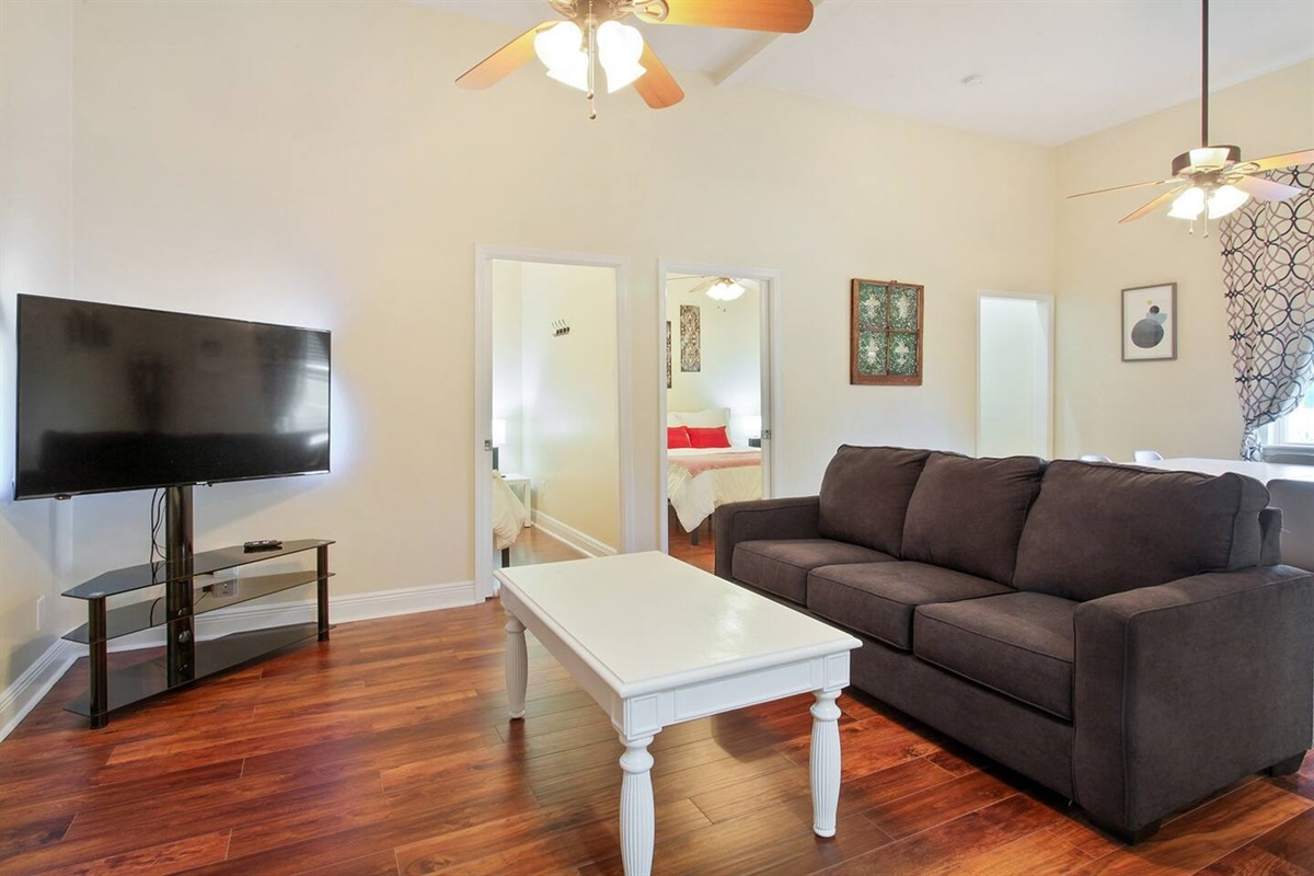 "Living room. Queen sleeper sofa. 60"" cable and smart tv. View into the two queen bedrooms."