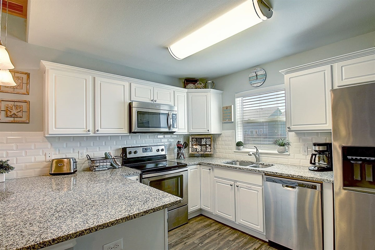 Fully Stocked Kitchen - Dishwasher, Stove, Microwave, double door refrigerator with icemaker & water dispenser.