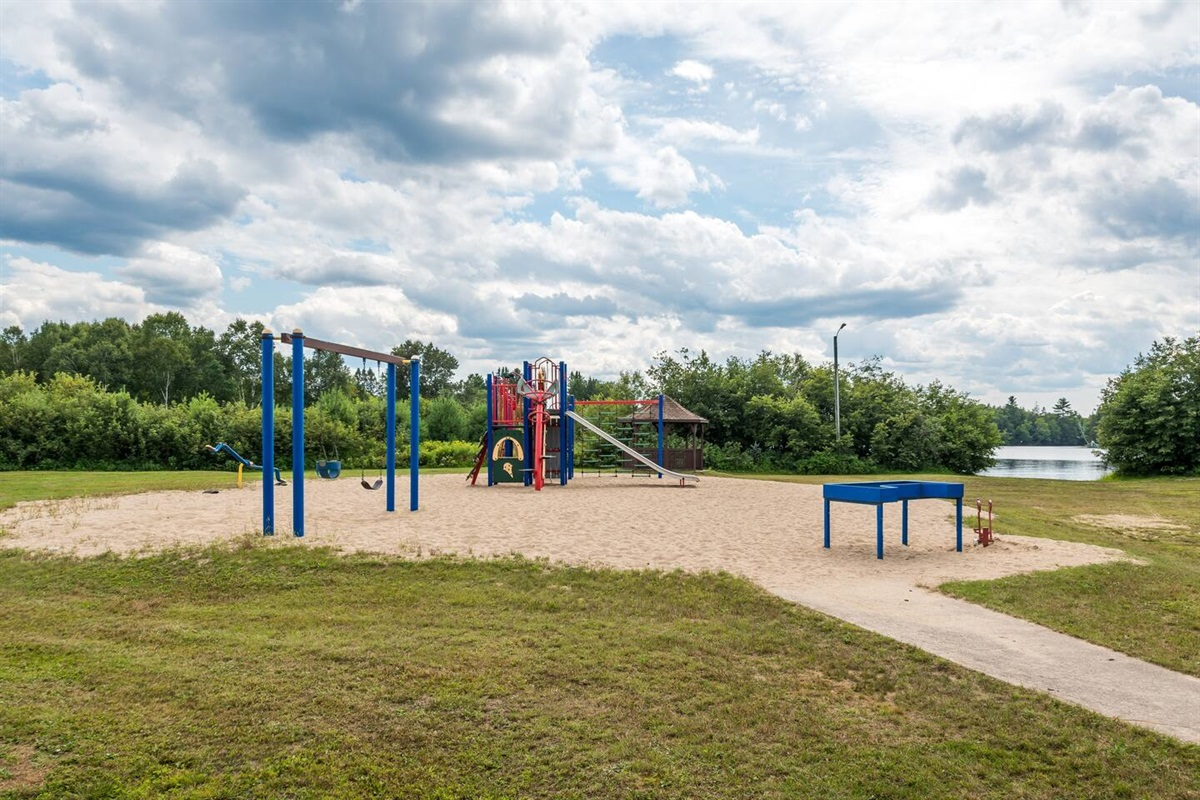 This playground is waking distance from the cottage or a few minutes drive. There is also a beach at the end of the lawn.