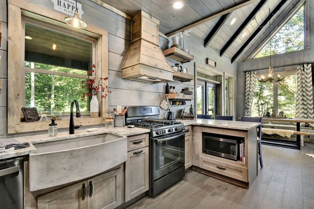 Enjoy a view of the forest and lots of space for cooking with this XL farmhouse sink