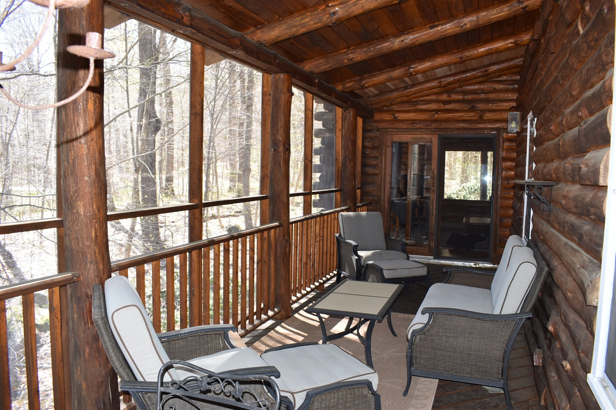 Screened in porch with comfortable seating