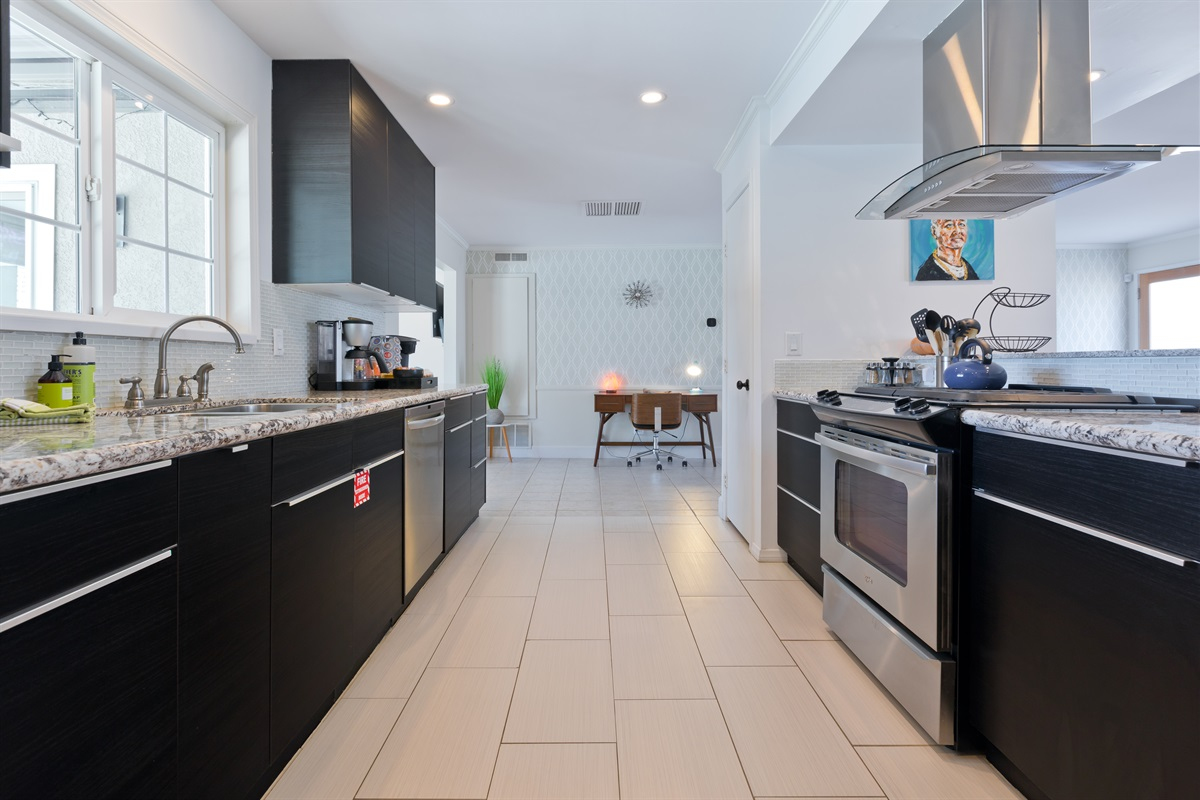 The kitchen features stainless steel appliances and all the cooking essentials you'd ever need, including a Ninja Professional Series Blender.