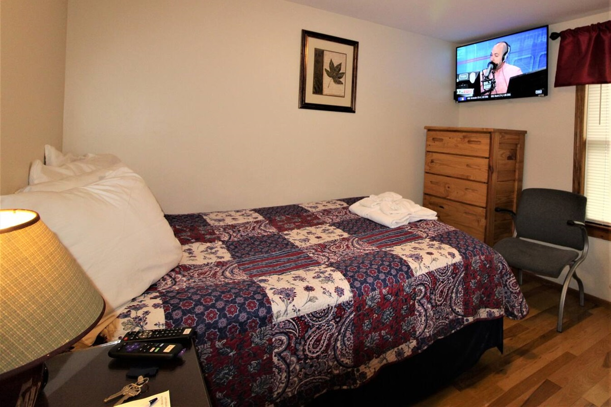 "Bedroom #1 with full bed.  Flat screen smart Roku TV's (43"" or larger) in every bedroom.  Just bring your favorite streaming app to never miss your favorite shows!"