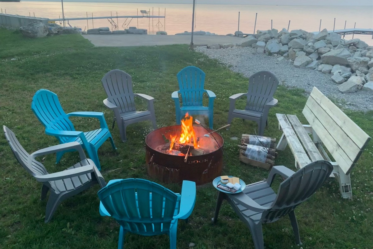 Tons of Adirondack and patio chairs to enjoy the sunsets and take to the pebble beach!