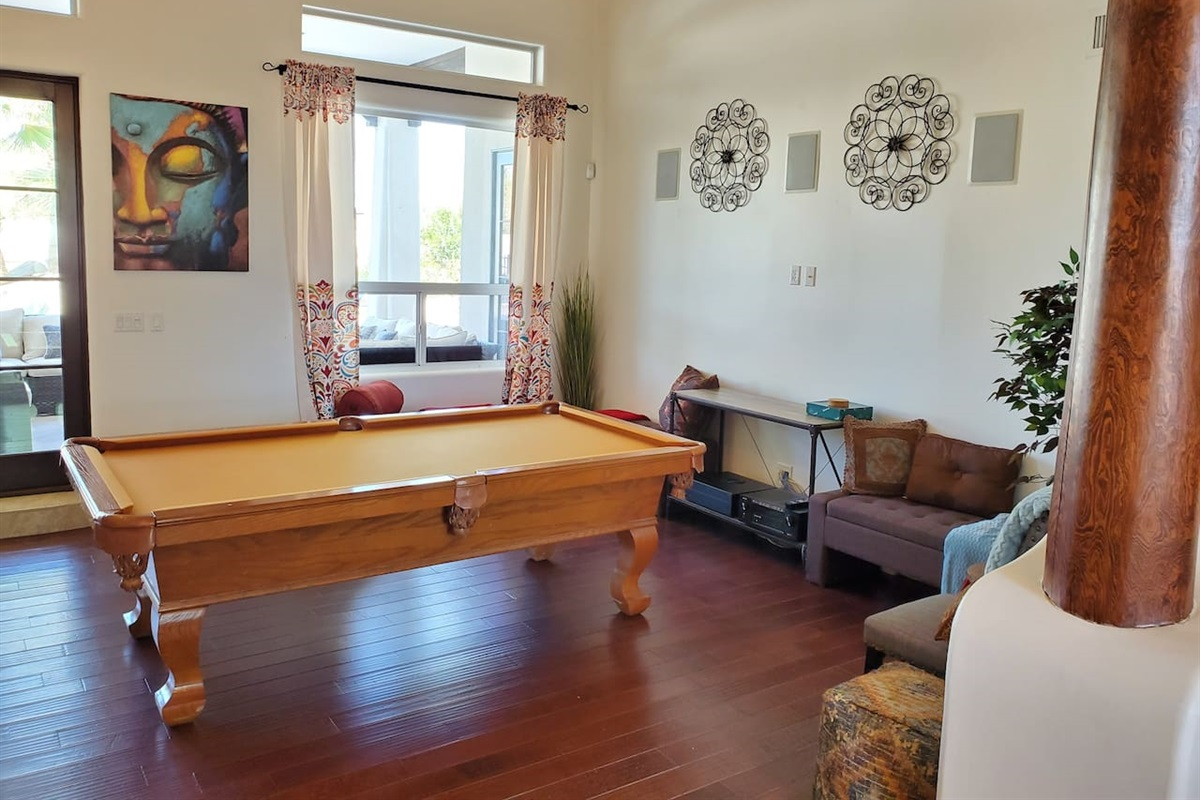 Pool table room with speaker controls