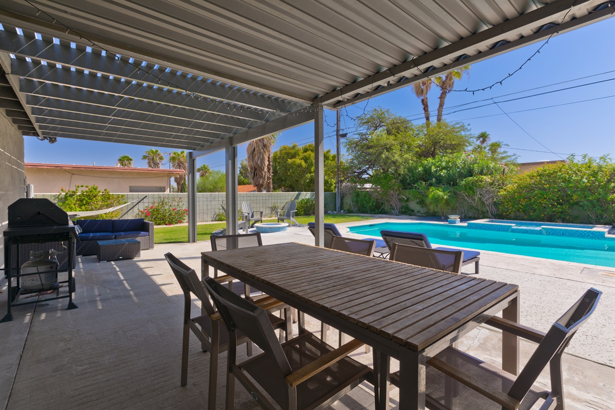 Gas BBQ, lounge seating, and outside dining table for up to six people.