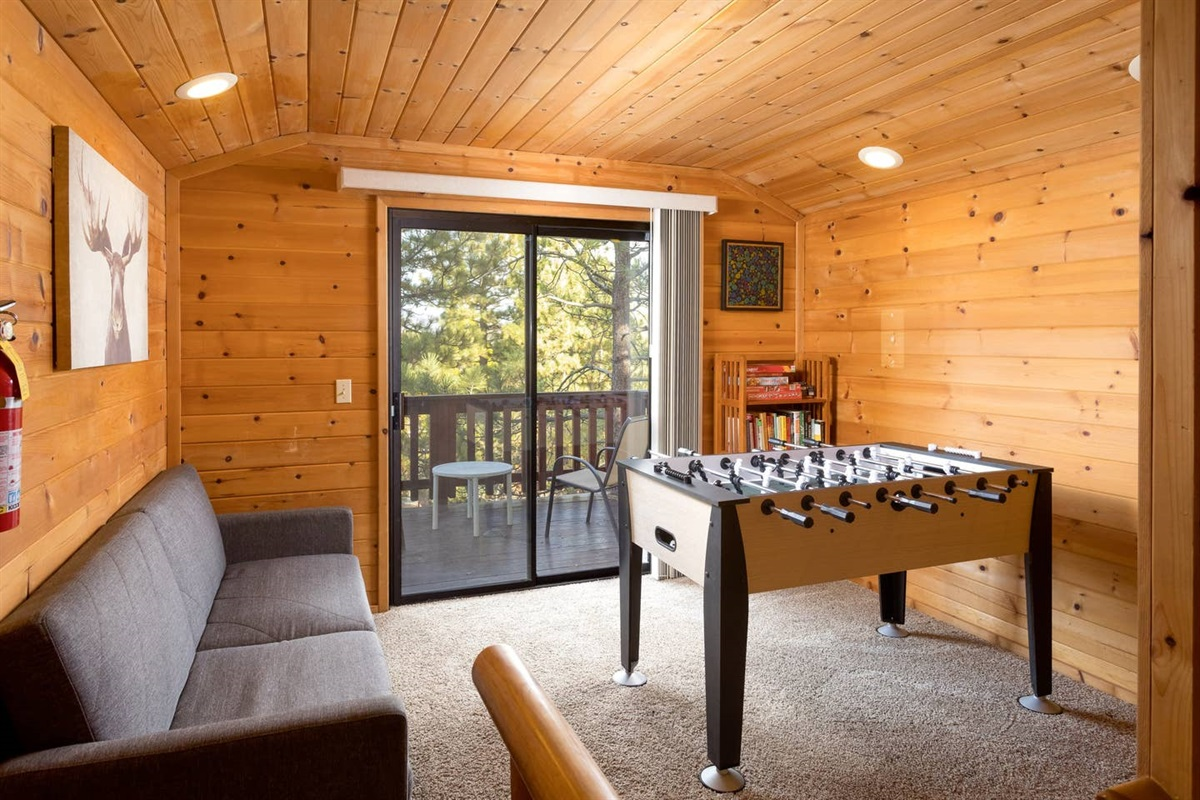 Upstairs nook with Fooseball, Couch, Board games and outdoor bistro patio with peek-a-boo lake views!