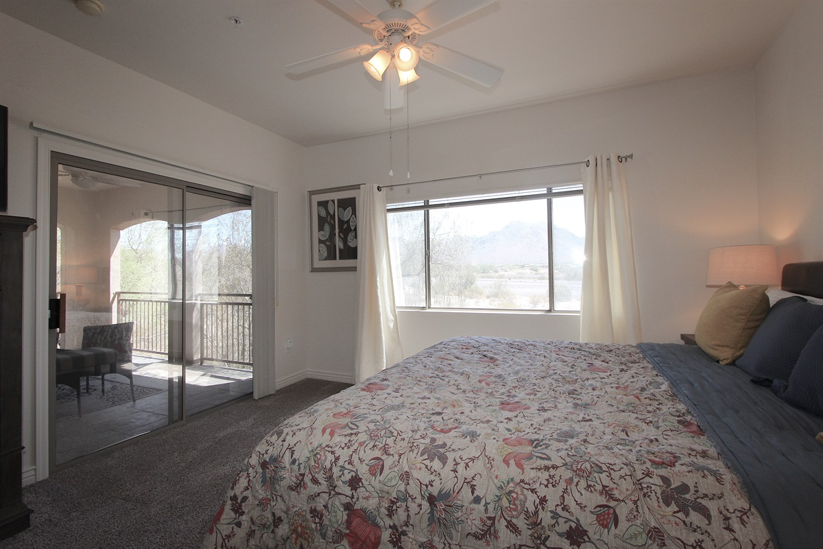 Master bedroom with a walk out to patio.
