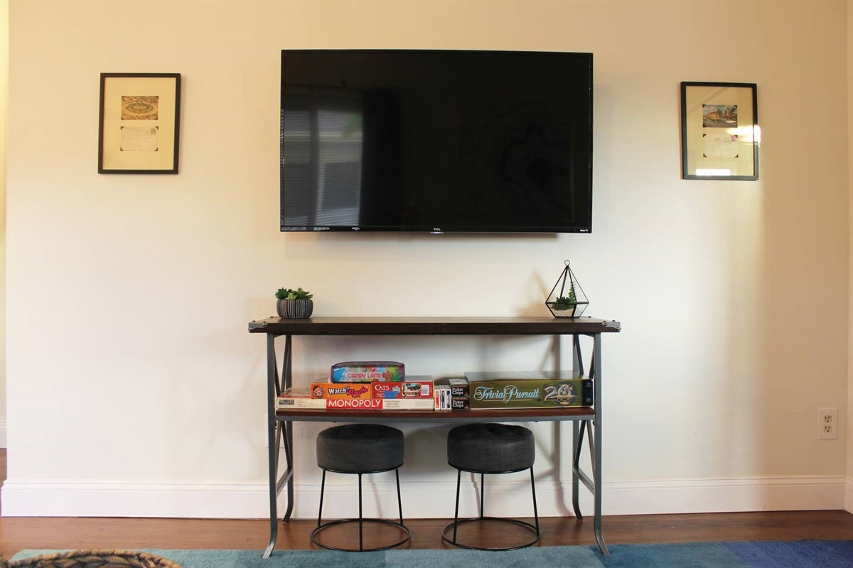 49-inch Roku HDTV with over 20 local (HD) channels, and Netflix ready. Also books, board games and an umbrella for those 10 minutes a day it rains.