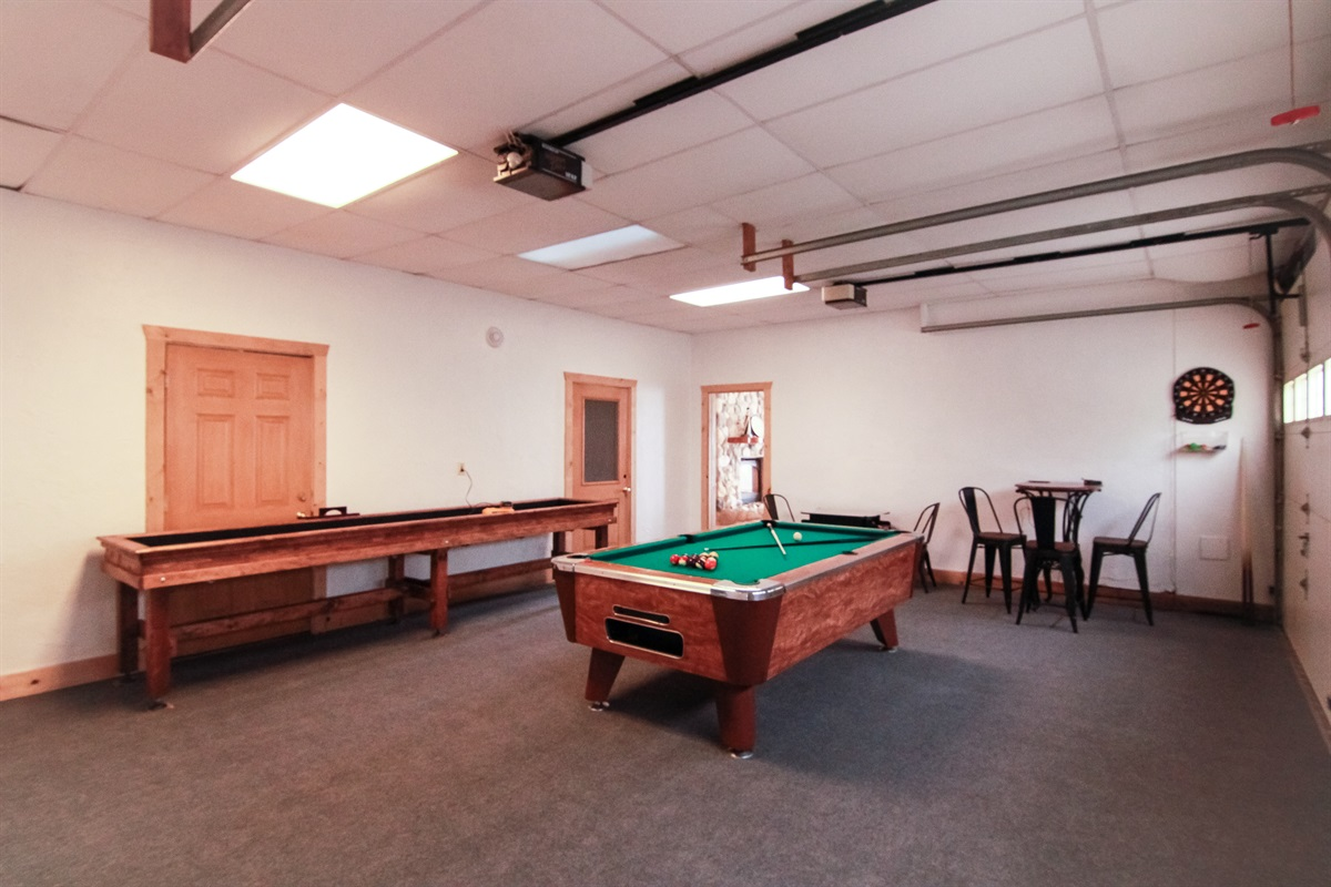 Custom shuffle board table, pool table, and darts. In the closet we have fishing gear, outdoor games, coolers, strollers, and everything else you'll need for an adventure!
