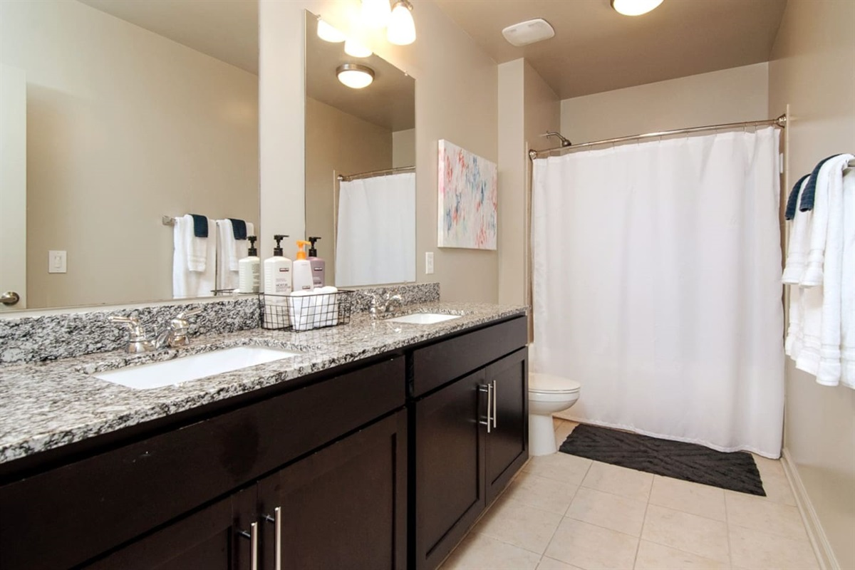 Squeaky clean bathroom with shampoo, conditioner, soap, and fresh towels for your stay!