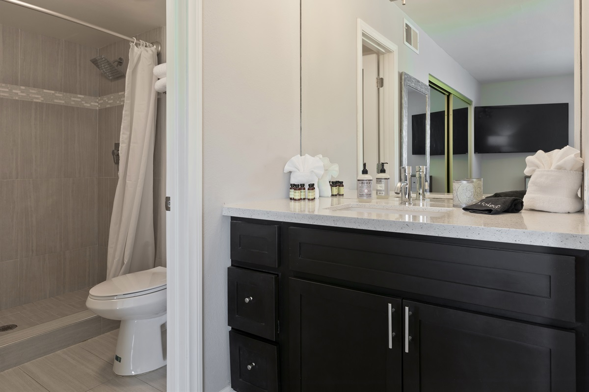 Large walk-in master bathroom shower with separated vanity.
