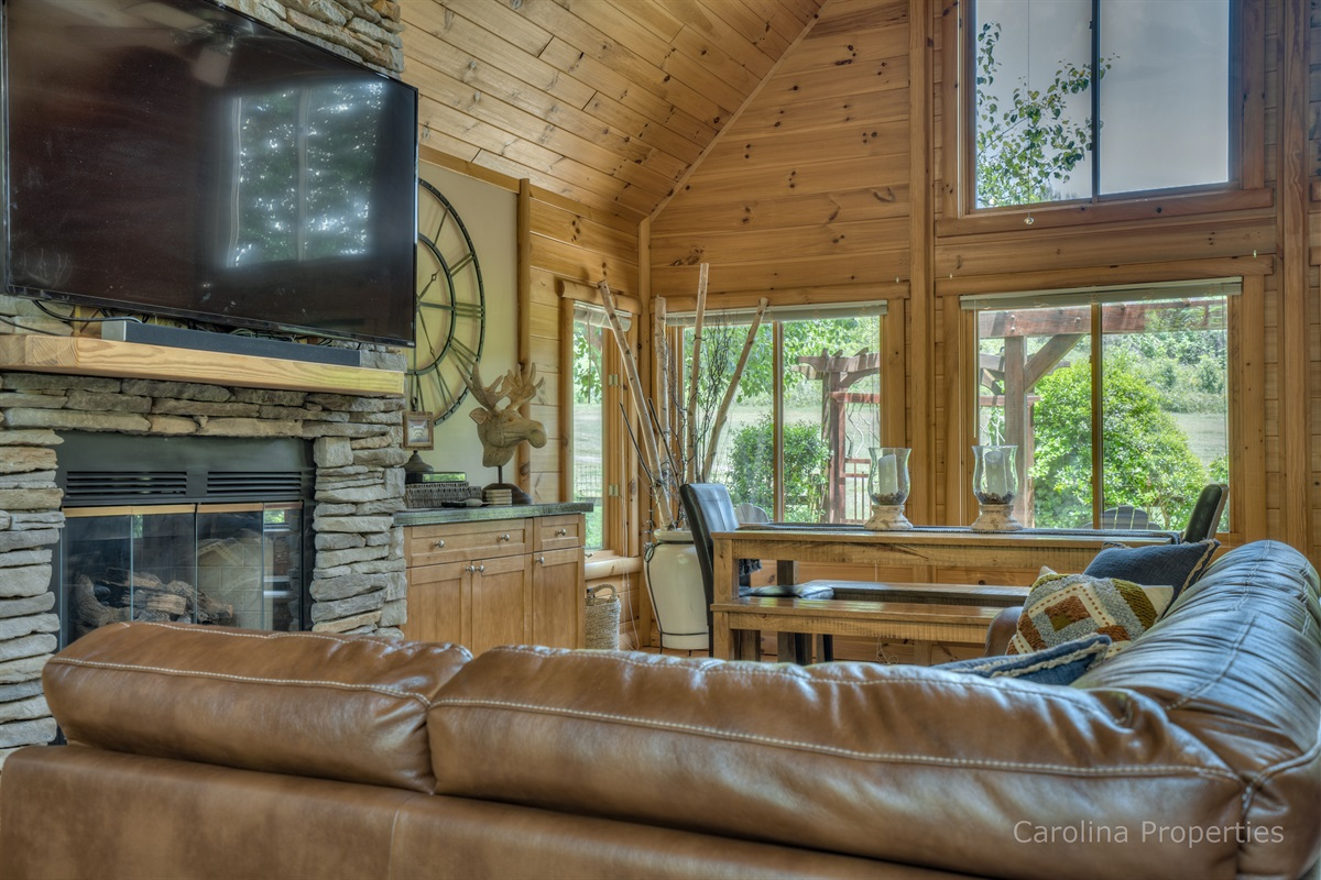 Main level living room with gas log fireplace