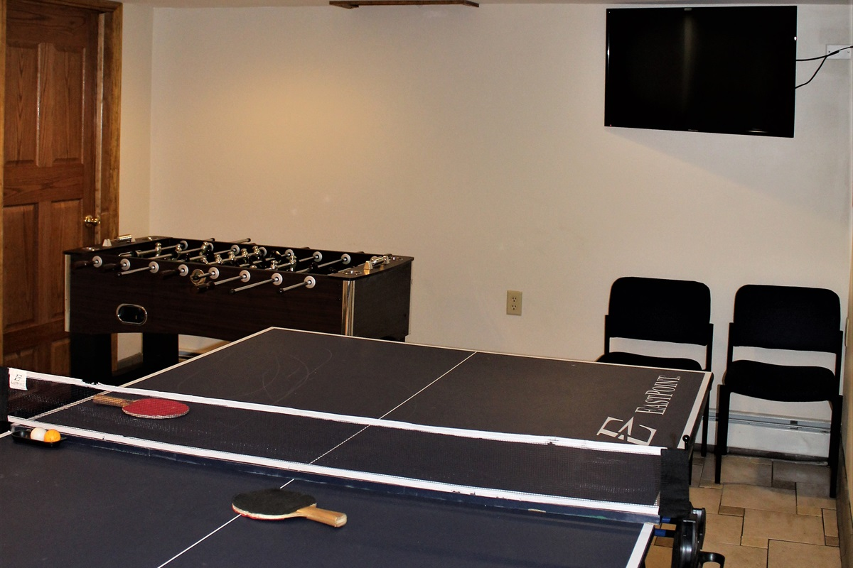 Game room with ping pong, foosball table and large flat screen smart Roku TV for rainy day fun, or downtime from the tournament