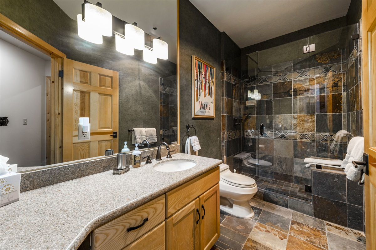 Large bathroom with walk in shower.