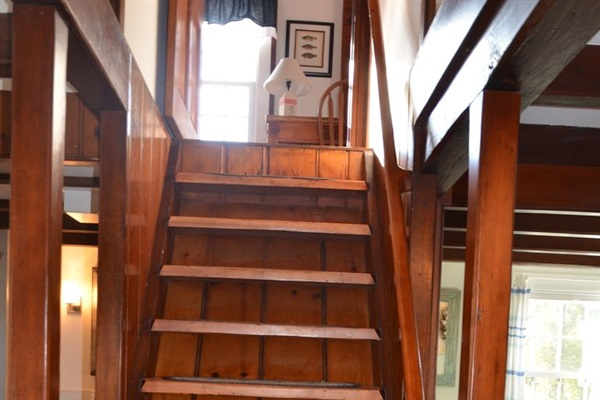 Steep yacht stairs to 2nd floor MBR ensuite reflect the nautical character.