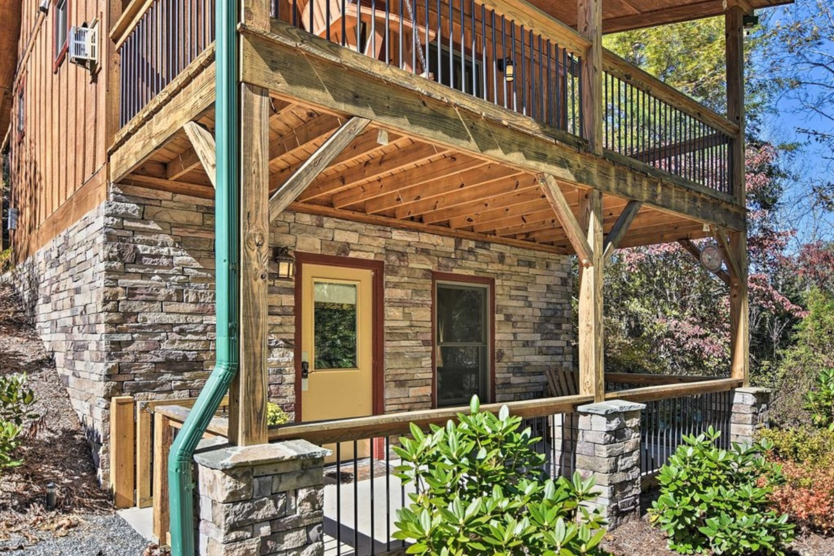 This home features a deck and covered patio below.