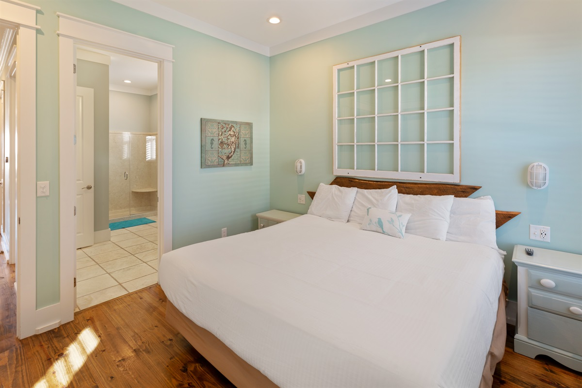 The Mermaid room is a king suite with attached, shared bath on the second floor overlooking the pool and yard area.