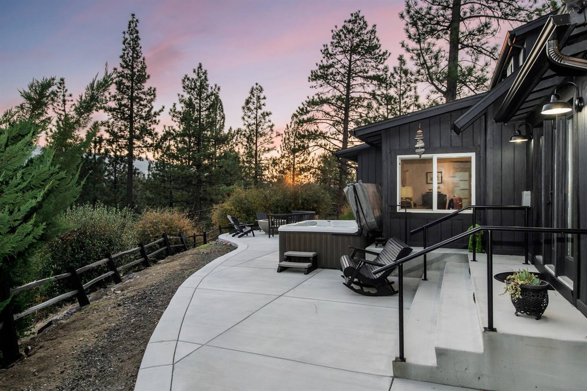 The 14,000+ square foot lot of Fox Haus features a large back deck with a firepit, hot tub, and outdoor dining area!