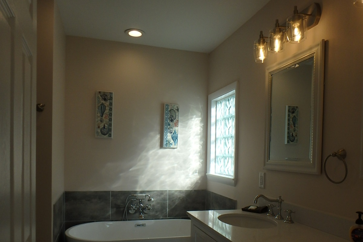 Double vanity and freestanding in completely renovated master bath
