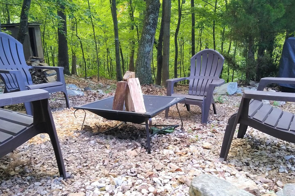 Outdoor fire pit, with wood ready to burn. Bring the marshmallows!