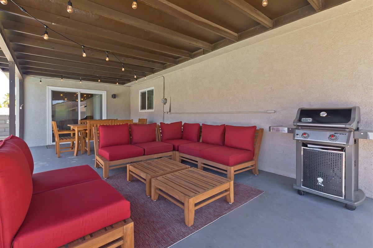 Patio lounge furniture with gas BBQ. Lots of shade comes in handy during the hot desert summers.