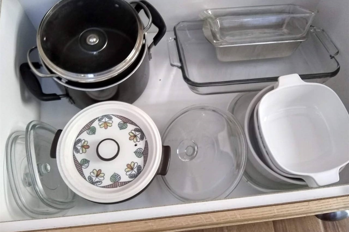 Full set of pots, pans, dishes, silverware, and glasses.