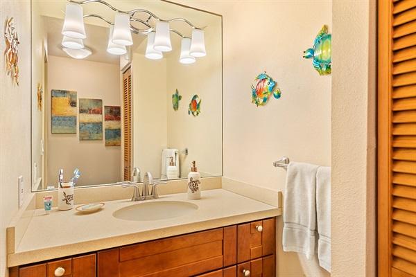 New vanity with quartz countertop and soft-close cabinets. Towels closet.