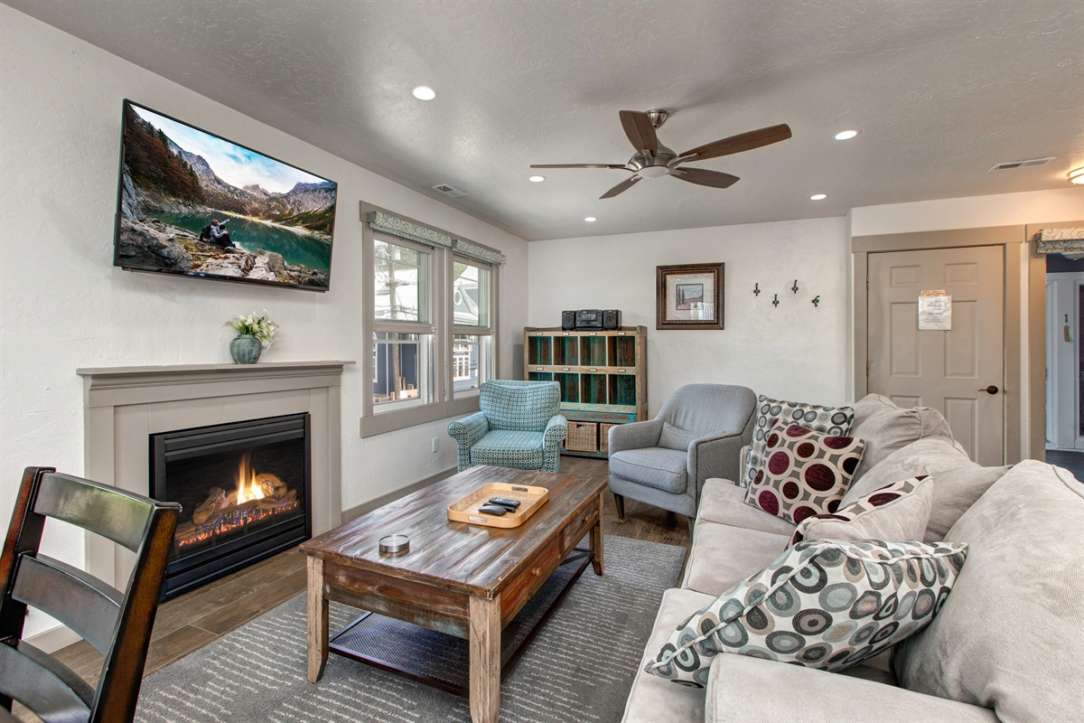 Living area with gas burning fireplace and queen size sleeper sofa
