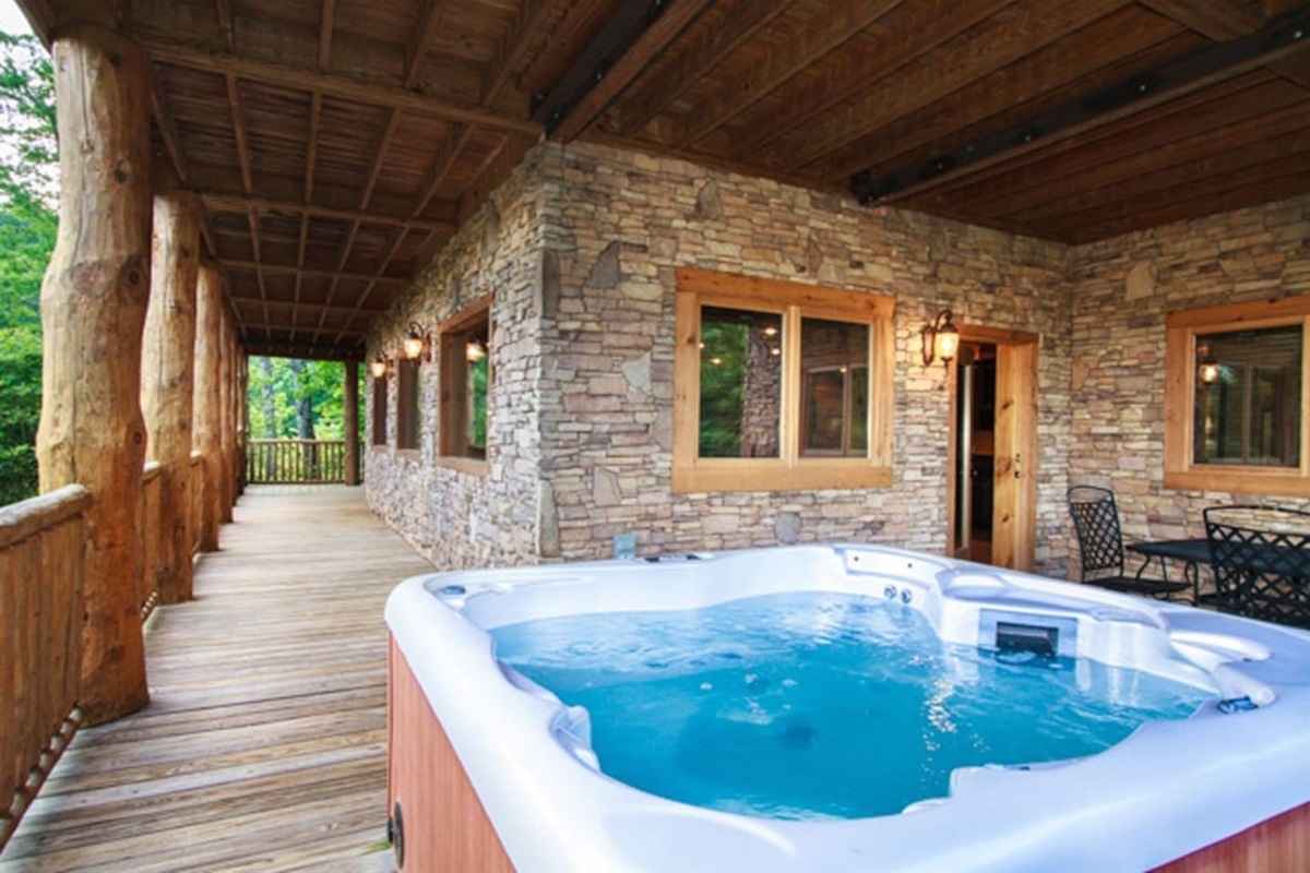 Luxurious 6-person hot tub on the lower deck with views of the Smoky Mountains