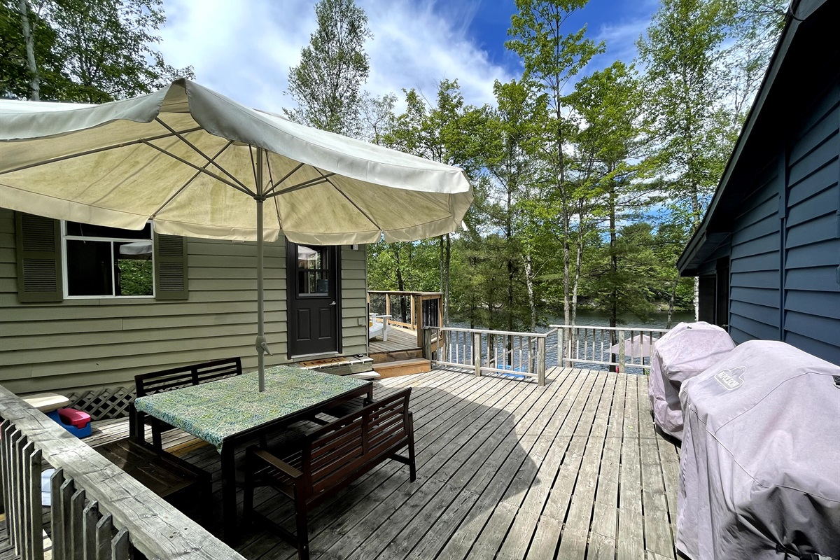Upper patio with 2 BBQ's, large table seats 8-10