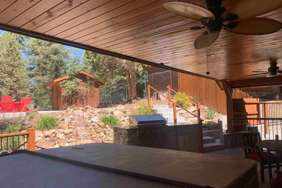 The back patio has everything you need for family fun, including a new 8-person spa, built in BBQ, horse-shoes, and patio furniture.