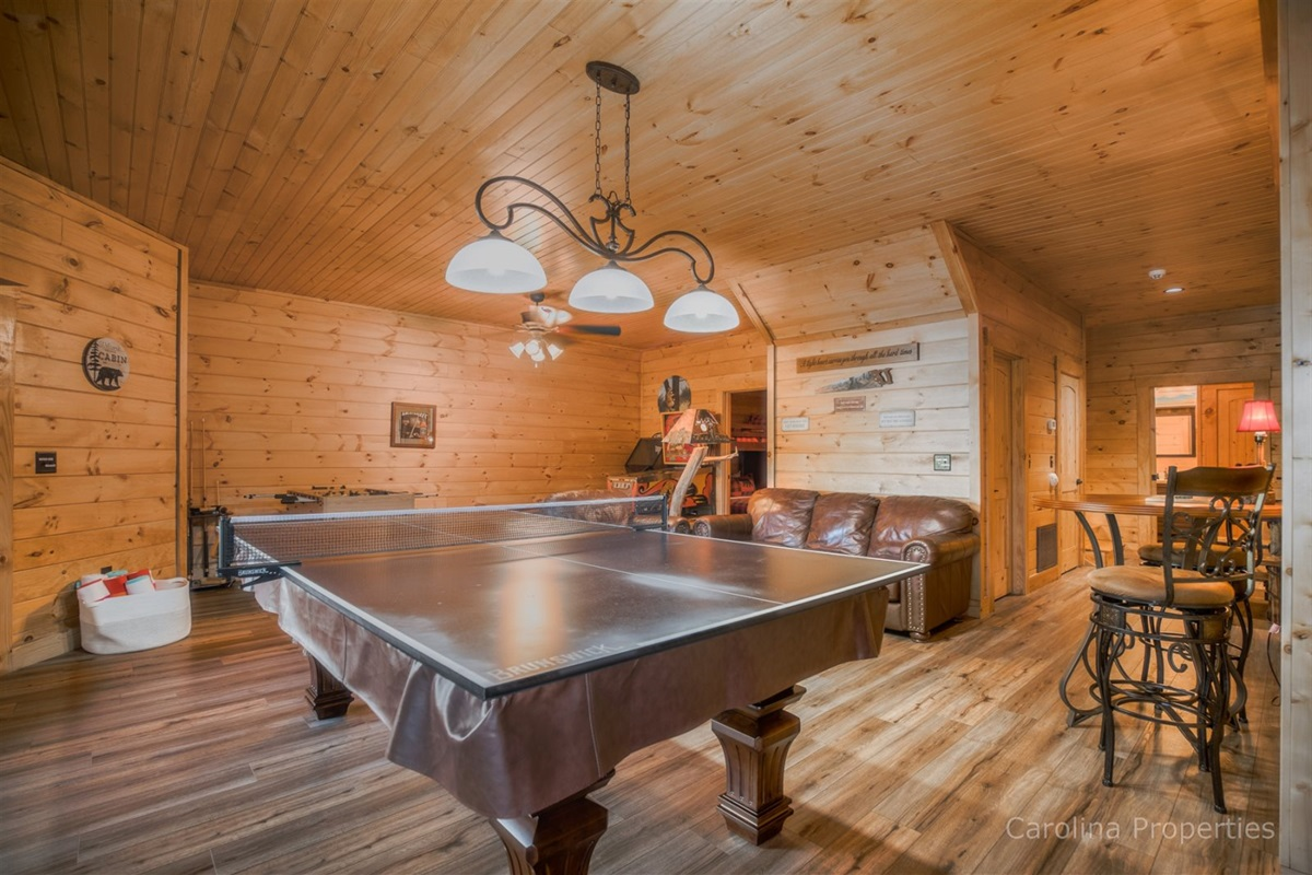 Awesome game room with air hockey, pool table, and more