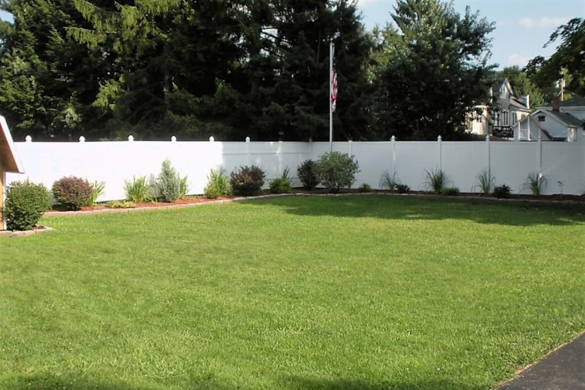 Large, private, well-manicured yard