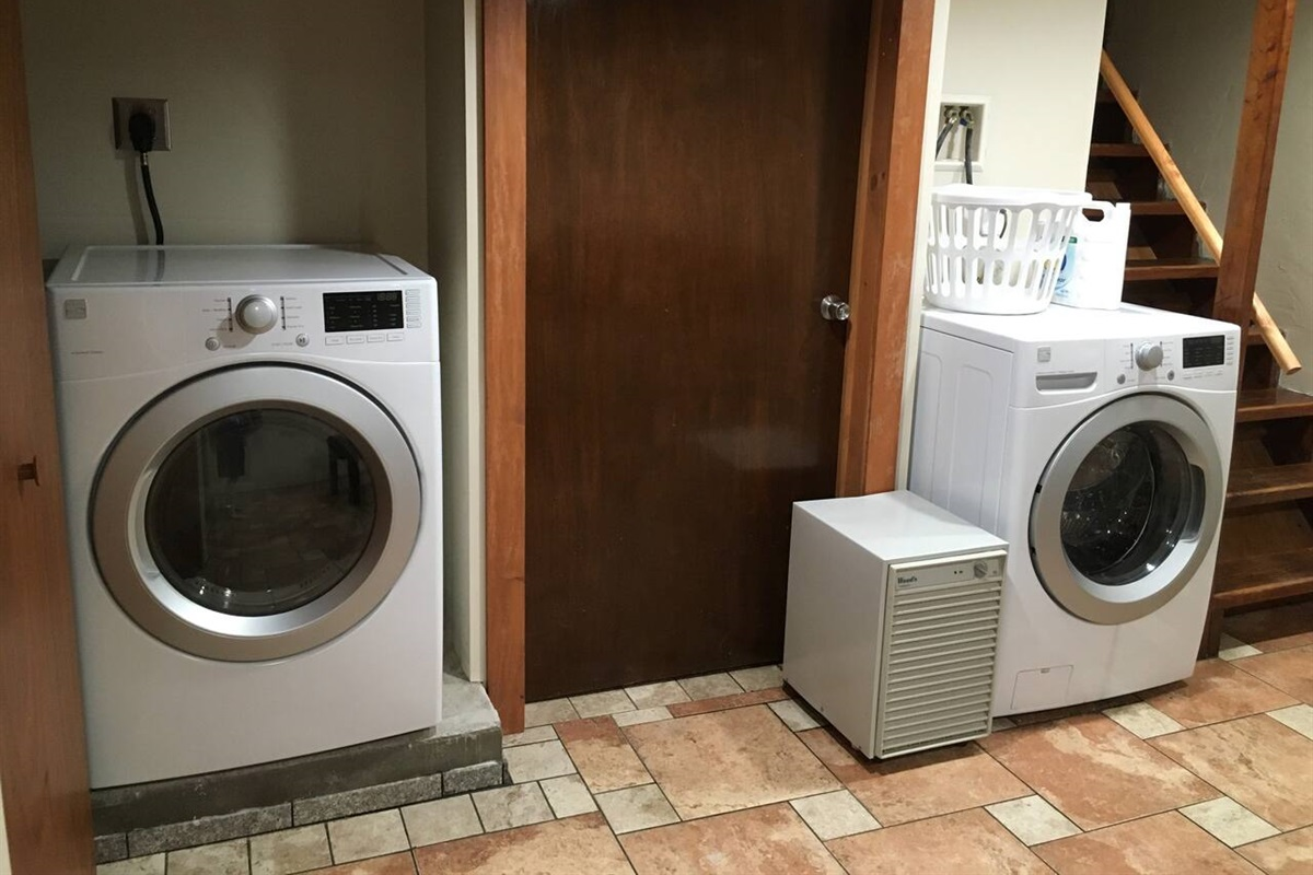 Modern washing machine and dryer in the game room downstairs