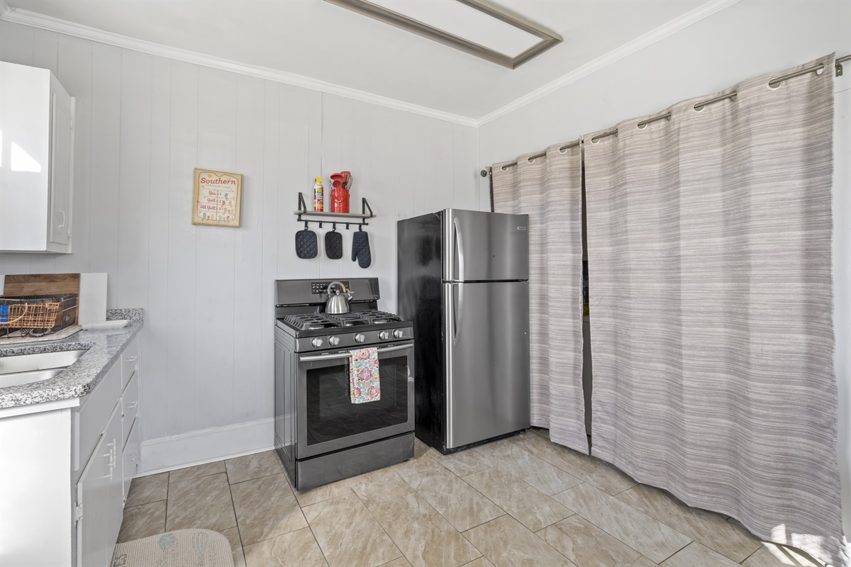 Gas range and full size refrigerator