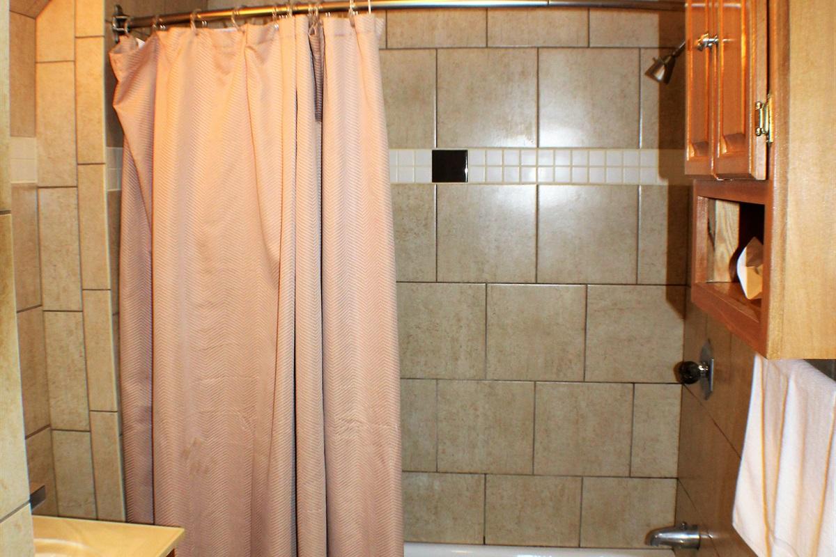 Fully tiled, modern bath